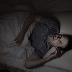 32500439 - top view image of mature man restless in bed from insomnia