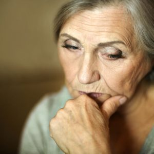 47929541 - portrait of a thoughtful sad elderly woman