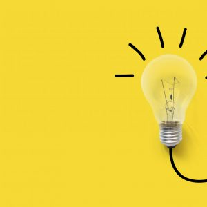 Creative thinking ideas brain innovation concept. Light bulb on yellow background