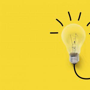Creative thinking ideas brain innovation concept. Light bulb on yellow background